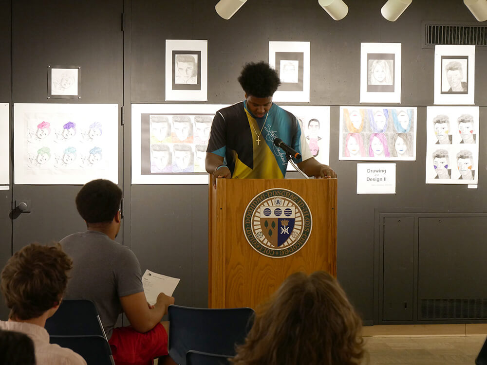 Photo of a student giving a reading at the Borgia Gallery