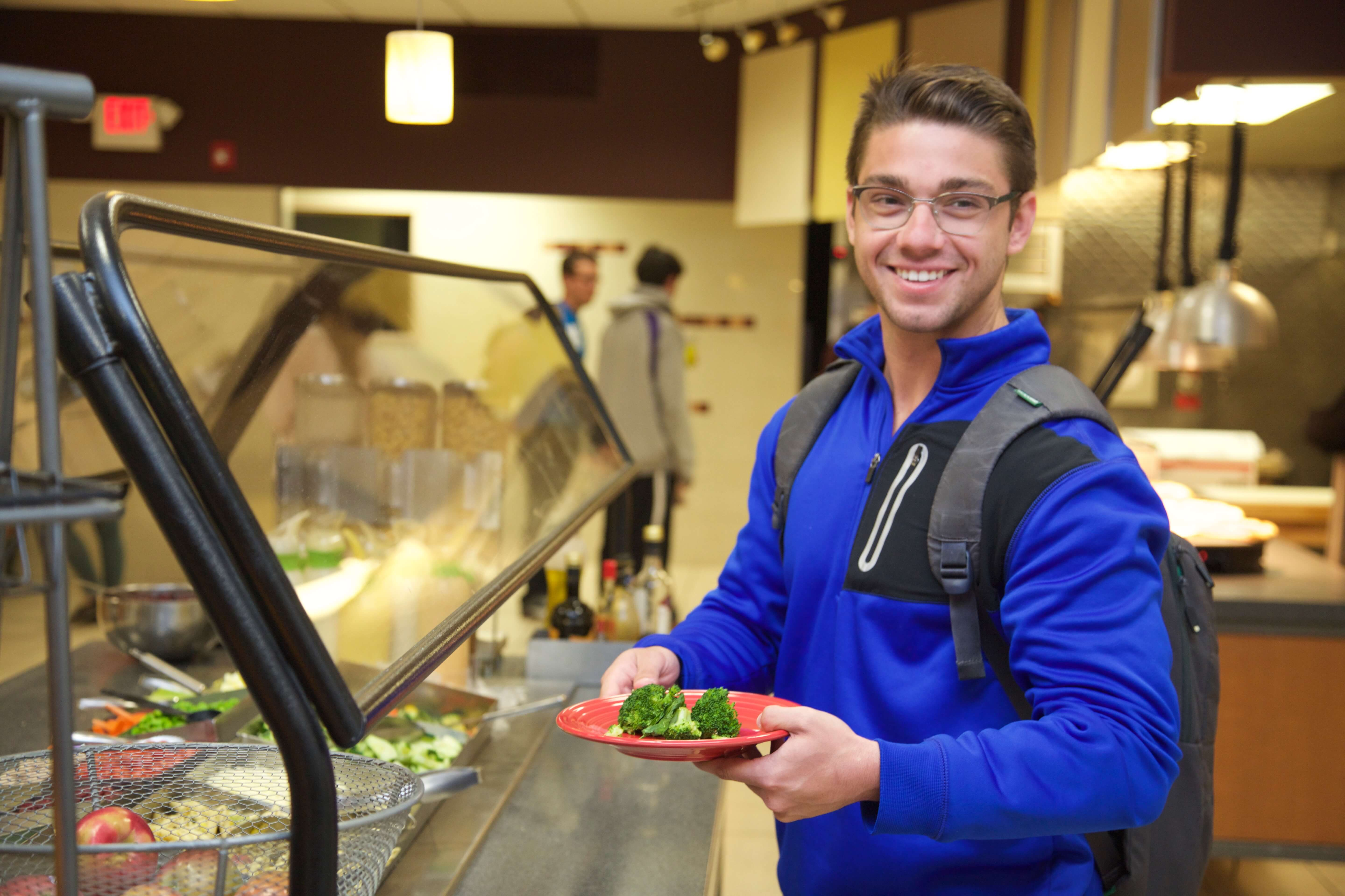 Photo of student in the cafeteria