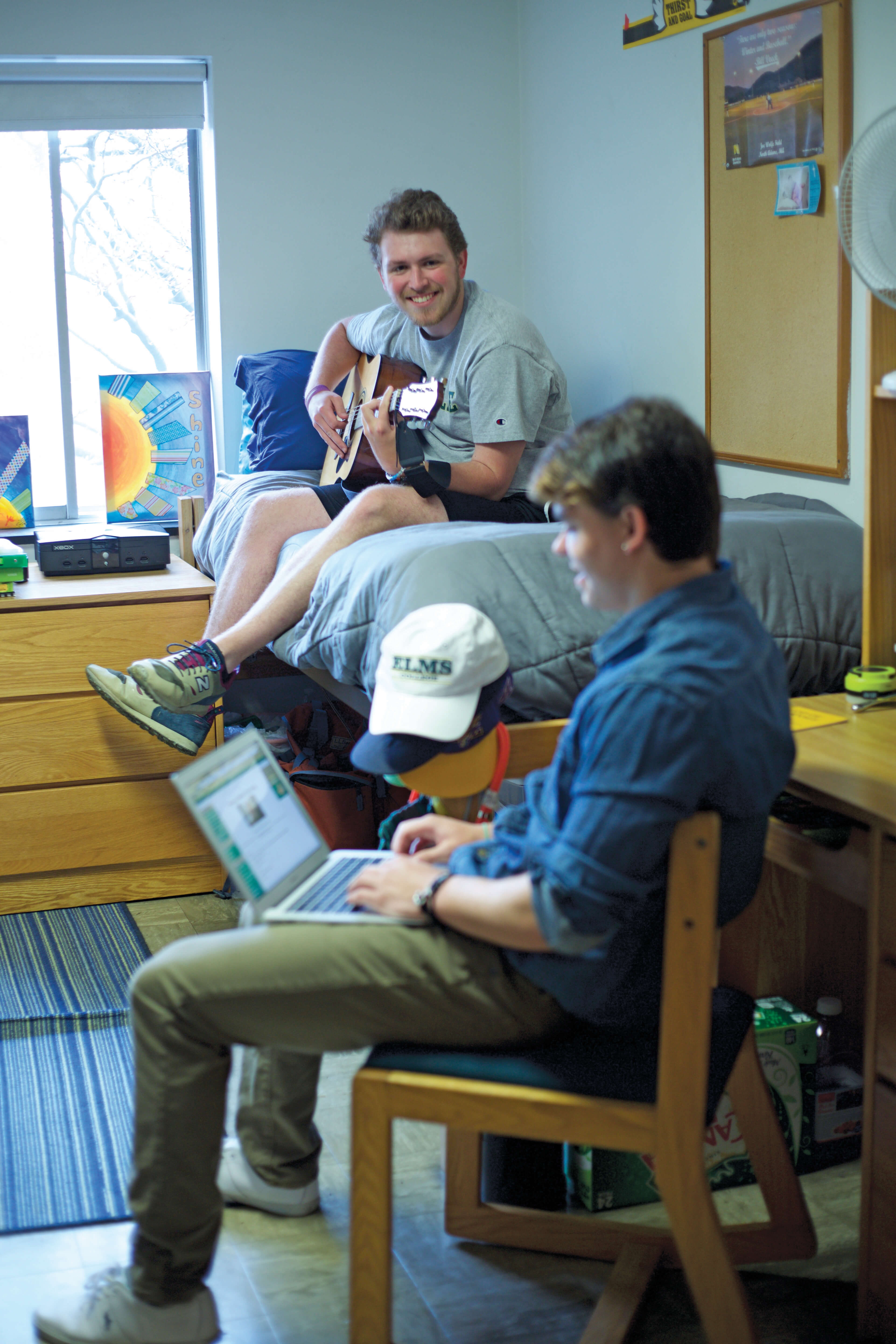 Photo of students in a dorm room in Rose William Hall