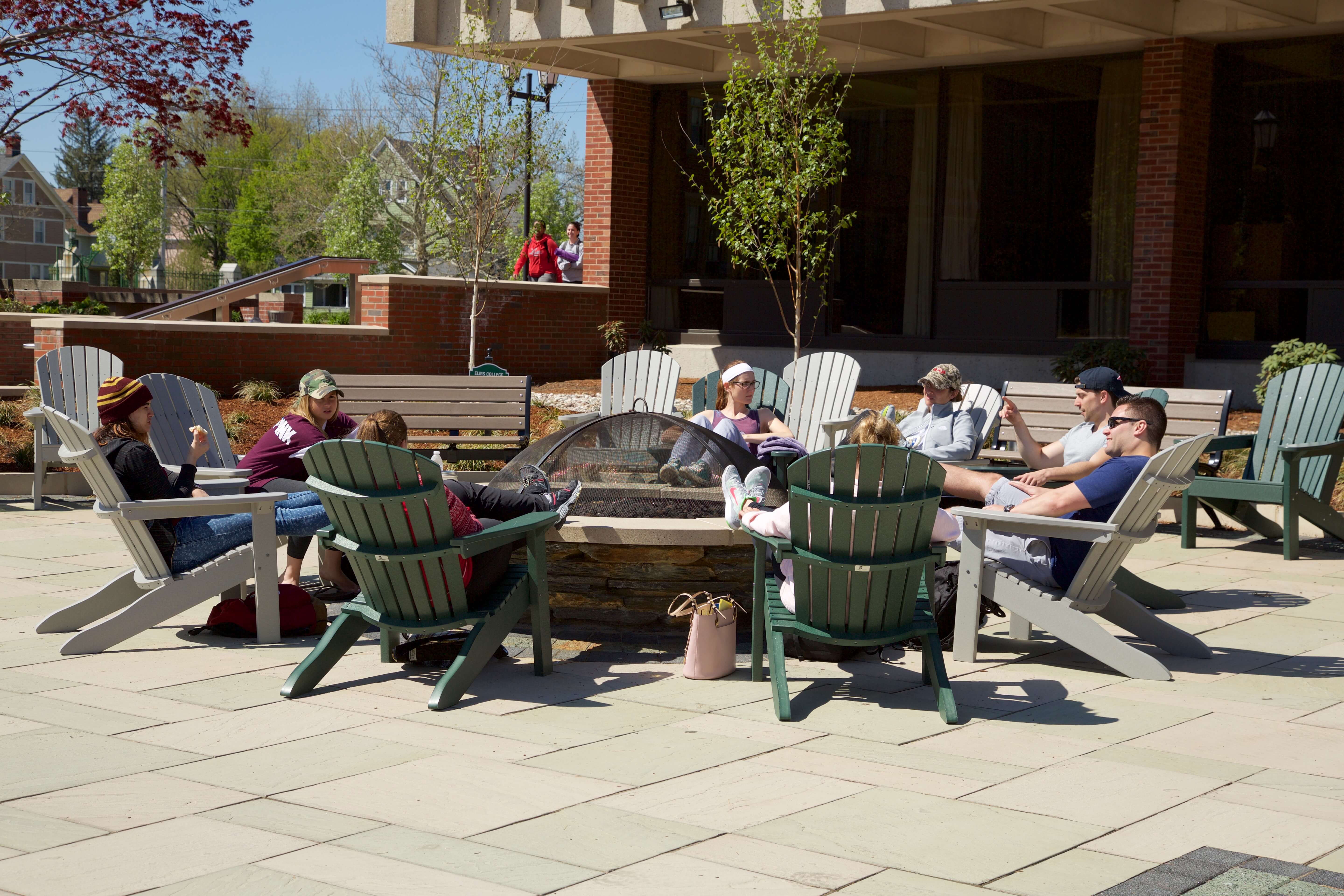 Photo of students at the firepit on the Keating Quad